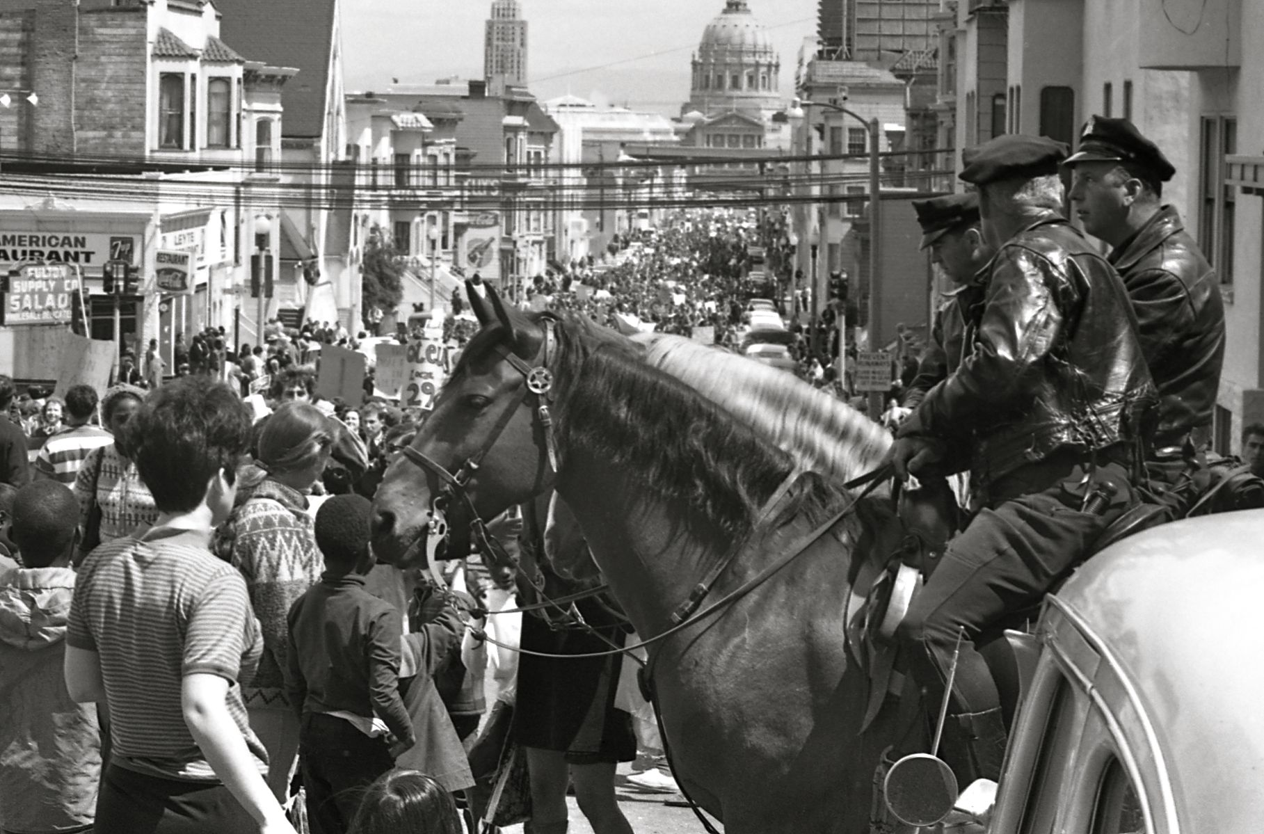 Mounted policemen watch a Vietnam War protest march in San Francisco April 1967